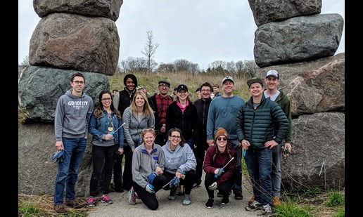 Good City volunteers in front of the stone arch at the Urban Ecology Center at Riverside Park